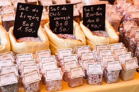 SINEU, MAJORCA, SPAIN - OCTOBER 18, 2017: Lemon salt (sal de limon), chili and orange salt (sal de chili naranja) and herbal salt (sal de hierbas) for sale at Sineu market Éditoriale
