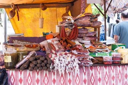 SINEU, MAJORCA, SPAIN - OCTOBER 18, 2017: Assortment of Spanish meat sausages (sobrasada, salchichon, fuet, chorizo) for sale at Sineu market Editorial
