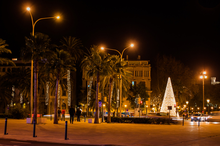 View of the Calle del Muelle (Carrer del Moll) with a Christmas tree in the old town of Palma, Majorca, Spain