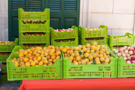 Bright orange apricots in boxes for sale on Apricot Fair in Porreres, Mallorca, Spain
