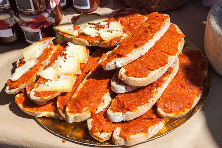 Bred with olive oil (pa amb oli) with sobrasada and cheese for sale in Porreres, Majorca, Spain