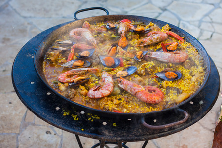 Traditional Spanish paella with seafood and chicken in a pan