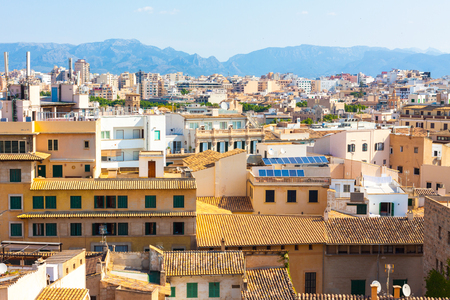 View over the rooftops of Palma de Mallorca with the mountains in the background from the terrace of the Cathedral of Santa Maria of Palma, also known as La Seu. Palma, Majorca, Spain Stock Photo