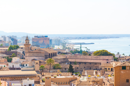 View over the rooftops of Palma de Mallorca with the sea in the background from the terrace of the Cathedral of Santa Maria of Palma, also known as La Seu. Palma, Majorca, Spain