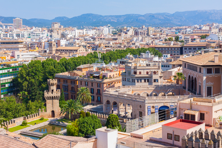 PALMA, MALLORCA, SPAIN - June 23, 2018: View over the rooftops  of Palma and Tramuntana mountains from  the terrace of the Cathedral of Santa Maria of Palma, also known as La Seu Editorial