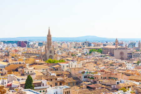 View over the rooftops and the Church of Santa Eulalia from  the terrace of the Cathedral of Santa Maria of Palma, also known as La Seu. Palma, Majorca, Spain