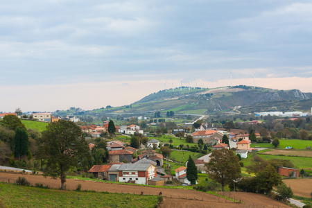 Small village with mountains in the background. Asturias, Spain Stock Photo