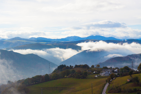 Green hills and mountains in the fog in Tineo, Asturias, Spain
