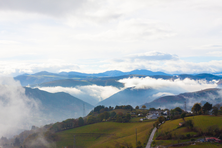 Foggy landscape with mountains in the background. Tineo, Asturias, Spain