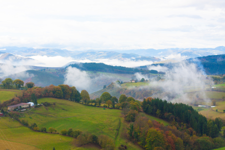 Green hills and mountains in the fog in Tineo, Asturias, Spain Stock Photo - 107711317