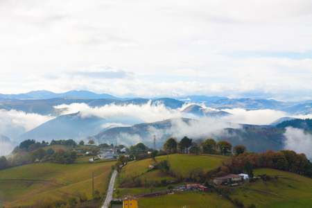 Green hills and foggy mountains in Tineo, Asturias, Spain