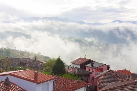 Mountains in the fog in Tineo, Asturias, Spain Stock Photo