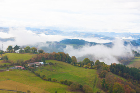 Green hills and mountains in the fog in Tineo, Asturias, Spain Stock Photo - 107711325