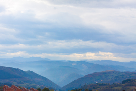 Dramatic blue sky with clouds and mountains in the background in Tineo, Asturias, Spain