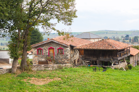 House with a typical granary, horreo, in Tineo. Asturias, Spain Stock Photo - 107711266