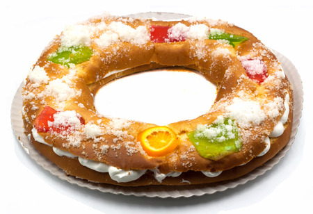 Roscon de reyes, typical Spanish dessert of Epiphany, isolated on white background Stock Photo - 111202441