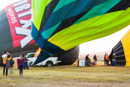 Manacor, Mallorca, Spain - October 27, 2019:  FAI European Hot Air Balloon Championship in Spain. Heating up the air inside the balloon with a burner