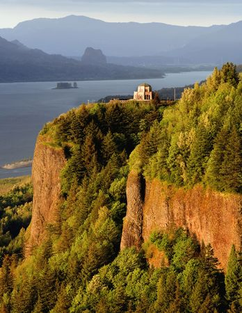 Serene landscape from Crown Point State Park of the Vista house in Oregon, close to Hood River.  Vista House is an interpretive center along the historic Columbia River hwy. Taken in evening light with its beautiful surroundings Stock Photo