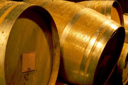Wine barrels in a cellar, fermenting wine