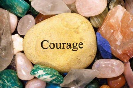 Rock with the word Courage