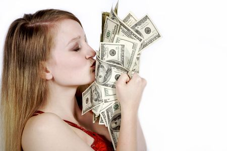 beautiful woman kissing a stack of money