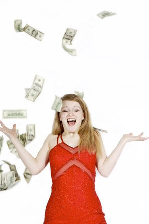 thrilling: Pretty girl in red dress with money falling all around her