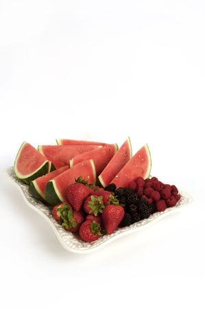 white platter filled with ripe fruit