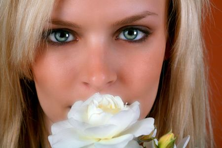 beautiful blond with green eyes holding a white rose Stock Photo - 2440625
