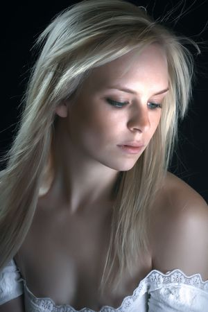 Beautiful blond with tranquil look on her face photo