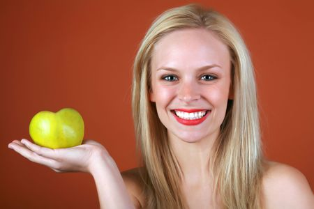 Healthy Blond girl holding a heart shaped green apple in her hand  Stock Photo - 2538259