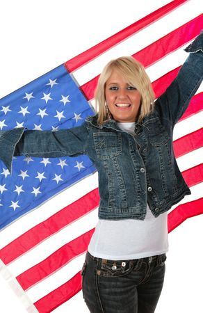 Cute blond in jeans and whte tee-shirt holding an American flag on white background Banque d'images