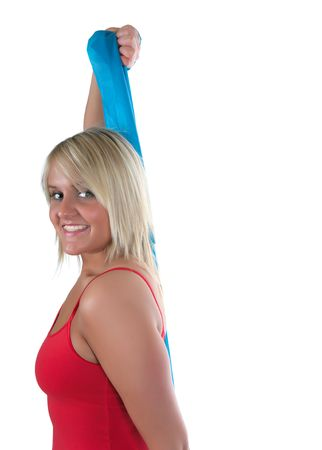 Pretty, fit blond girl with big smile using a blue band to exercise photo