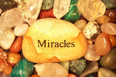 Stones and Crystals with a rock the says miracles on it Stock Photo - 2640730