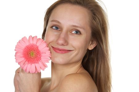 Pretty blond with a smile holding a pink gerber daisy on white background Stock Photo - 2804965