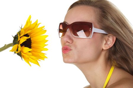 Beautiful Sexy blond holding a sunflower blowing a kiss