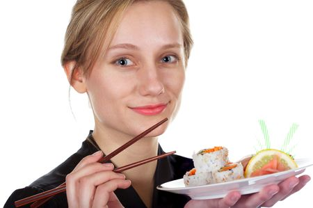 Pretty girl eating sushi with chopsticks Stock Photo