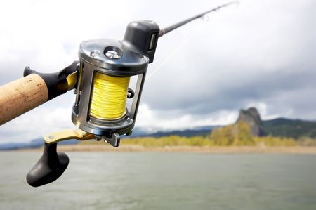 Salmon Fishing reel hanging over river on a cold foggy morning Stock Photo