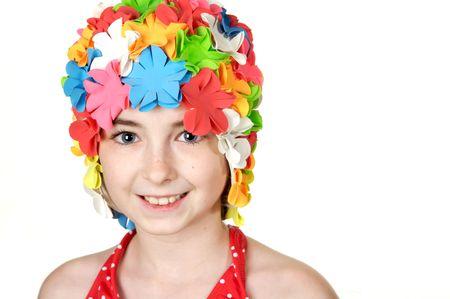 Beautiful little girls in a flowered swim cap