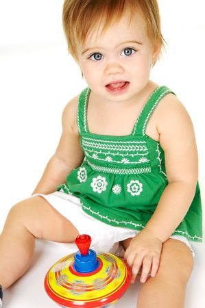 Cute toddler playing with a top with a big smile