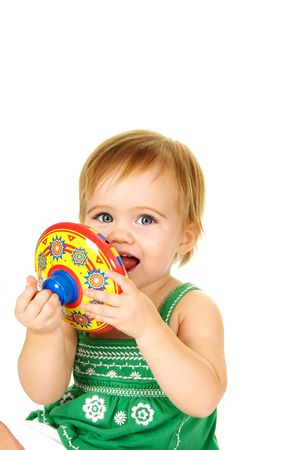 Cute toddler holding a top witha big smile Stock Photo