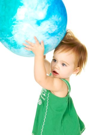 Cute toddler holding a big Globe over her head