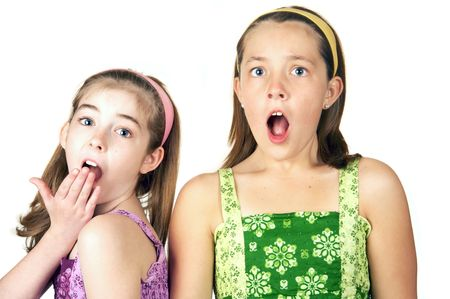 awe: Two cute little girls with a surprised look on their faces Stock Photo