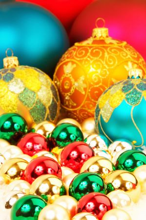forground: Colorful Chrismas tree ornaments focus on the forground, blurred background