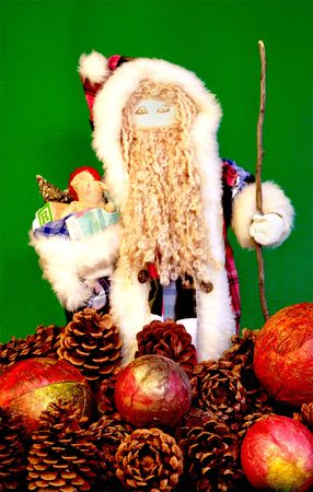Santa and Pine cones on green background
