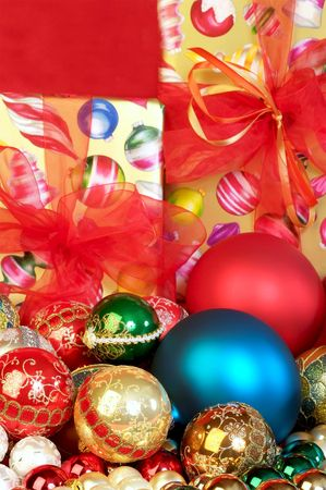 Colorful Chrismas tree ornaments and presents focus on the foreground, blurred background Stock Photo