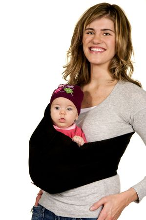 Fashionable Mama with her baby in a sling