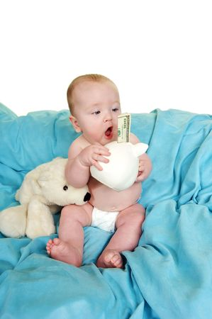 Baby with a surprised look at his piggy bank with a hundred dollor bill sticking out  Stock Photo - 3643761