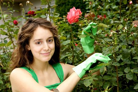 Beautiful girl in a rose garden
