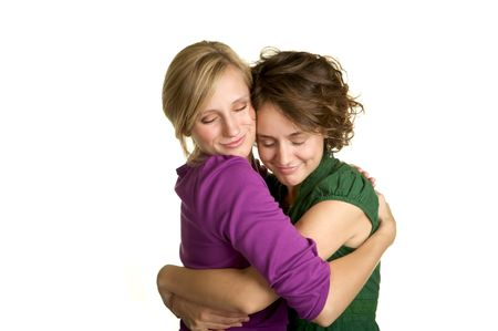 Two sisters giving each other a warm hug Stock Photo - 3688068