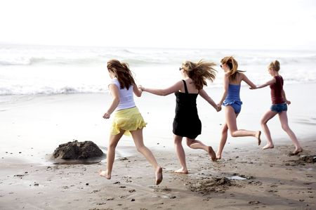 Abstract of best friends running into the ocean together Stock Photo - 3688081